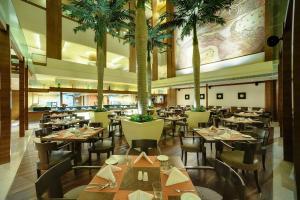 A restaurant or other place to eat at Vivanta Goa, Panaji