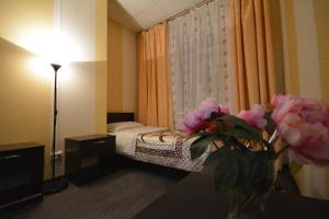 Кровать или кровати в номере Отель Карат