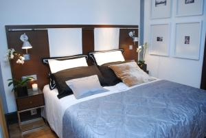 A bed or beds in a room at Browns Boutique Hotel