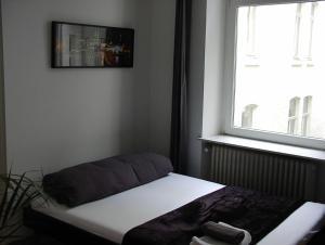 Ein Bett oder Betten in einem Zimmer der Unterkunft Ferienwohnung Bankwitz
