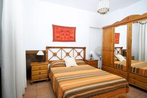 Cama o camas de una habitación en Apartamentos Gumiel