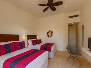 Een bed of bedden in een kamer bij HM Playa del Carmen