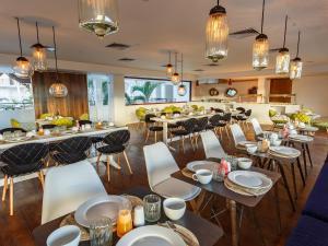 Een restaurant of ander eetgelegenheid bij HM Playa del Carmen