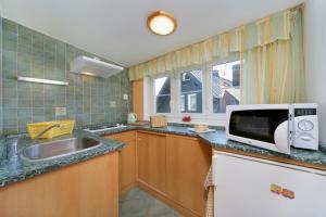 Кухня или мини-кухня в Pension Alba