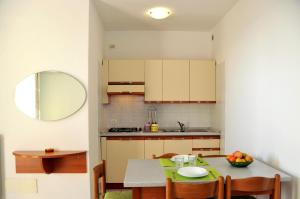 Kuchyň nebo kuchyňský kout v ubytování Isola di Pasqua