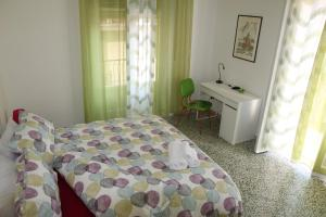 A bed or beds in a room at Opulenta Salernum Apartment