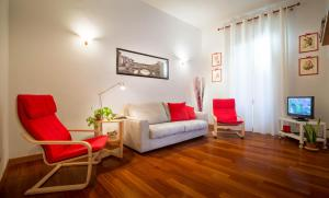 A seating area at Signoria Charme Apartment