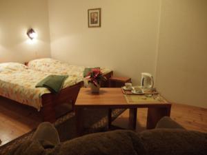 Posteľ alebo postele v izbe v ubytovaní Parks Guest House