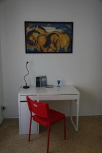 A television and/or entertainment centre at Opulenta Salernum Apartment