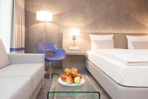 Ein Zimmer in der Unterkunft relexa hotel München