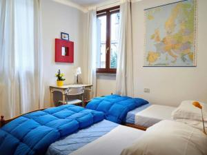 A bed or beds in a room at Casa Vacanze La Torre