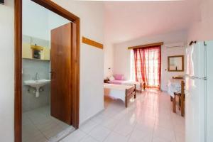 A bathroom at Merryland Studios & Apartments