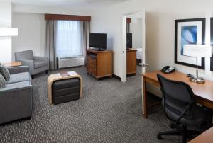 A television and/or entertainment center at Homewood Suites by Hilton Omaha - Downtown