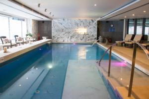 The swimming pool at or near Hotel Nikopolis