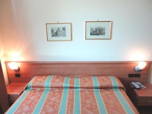 Кровать или кровати в номере Bergamhotel