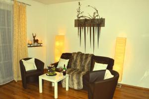 Ein Sitzbereich in der Unterkunft Haus Franzis
