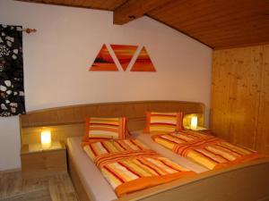 Ein Bett oder Betten in einem Zimmer der Unterkunft Haus Anneliese