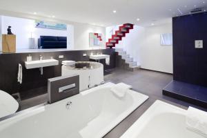 Ein Badezimmer in der Unterkunft Hotel Schloss Hertefeld