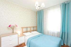 Кровать или кровати в номере Сервисные Апартаменты на Белорусской