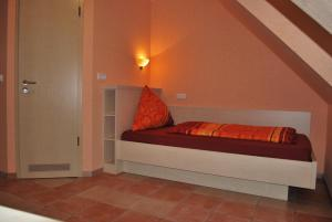"A bed or beds in a room at Hotel Gasthof ""Goldener Engel"""