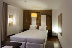 Кровать или кровати в номере Porto Trindade Hotel