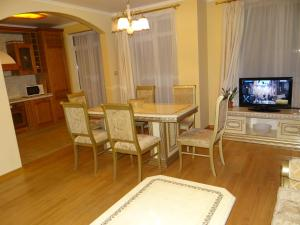 A television and/or entertainment center at Luxury Versailles Apartments Center Opera