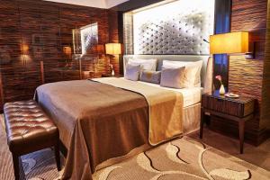 Ein Bett oder Betten in einem Zimmer der Unterkunft Steigenberger Frankfurter Hof