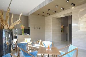 Ein Restaurant oder anderes Speiselokal in der Unterkunft Hotel Cubo