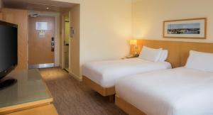 A bed or beds in a room at Hilton Dublin Airport