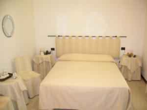 Un ou plusieurs lits dans un hébergement de l'établissement Hotel Agli Artisti
