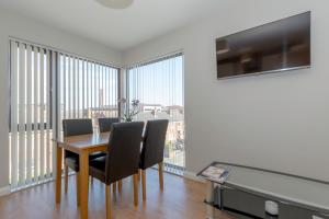 A television and/or entertainment center at Bt1 Apartments - Ivy House