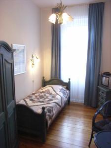 Ein Bett oder Betten in einem Zimmer der Unterkunft Hotel Villa im Steinbusch