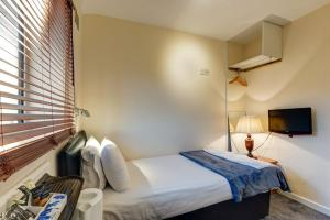 A bed or beds in a room at The Commodore Hotel