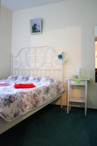 Кровать или кровати в номере Апартаменты Муза
