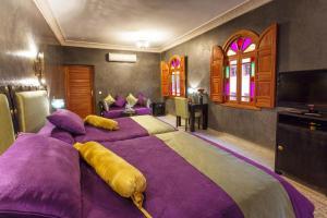 Postel nebo postele na pokoji v ubytování Riad Andalib