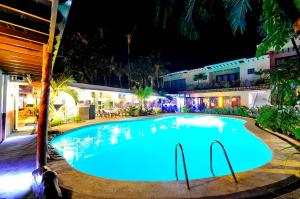 The swimming pool at or close to Red Coconut Beach Hotel Boracay