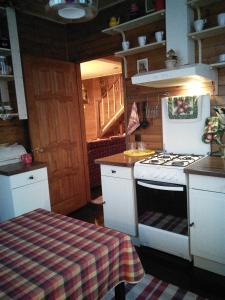 Кухня или мини-кухня в House On Tsvetochnaya