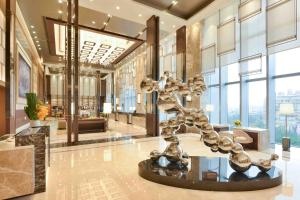 The fitness center and/or fitness facilities at Courtyard by Marriott Taipei