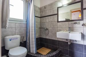 A bathroom at Thea Home Hotel