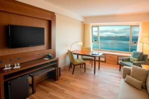 A television and/or entertainment center at Arakur Ushuaia Resort & Spa