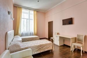 Кровать или кровати в номере Отель Островский