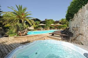 The swimming pool at or near Lodge de Charme A Cheda