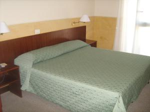 A bed or beds in a room at Hotel Columbus