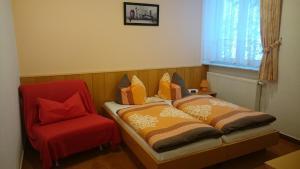 Ein Bett oder Betten in einem Zimmer der Unterkunft Pension Kapellenstein