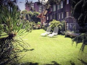 Сад в BasicRooms Hotel