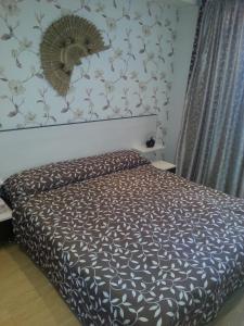 Кровать или кровати в номере Apartments Mori Plaza
