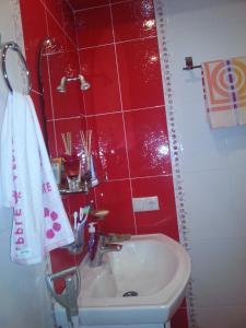 Ванная комната в Apartments Mori Plaza