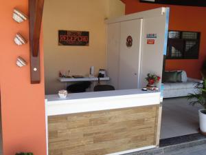 The lobby or reception area at Pousada Solar Ponta Negra