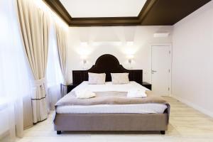 Кровать или кровати в номере Отель «Далиси»