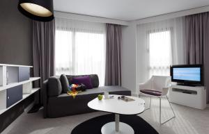 A seating area at Novotel Suites Malaga Centro